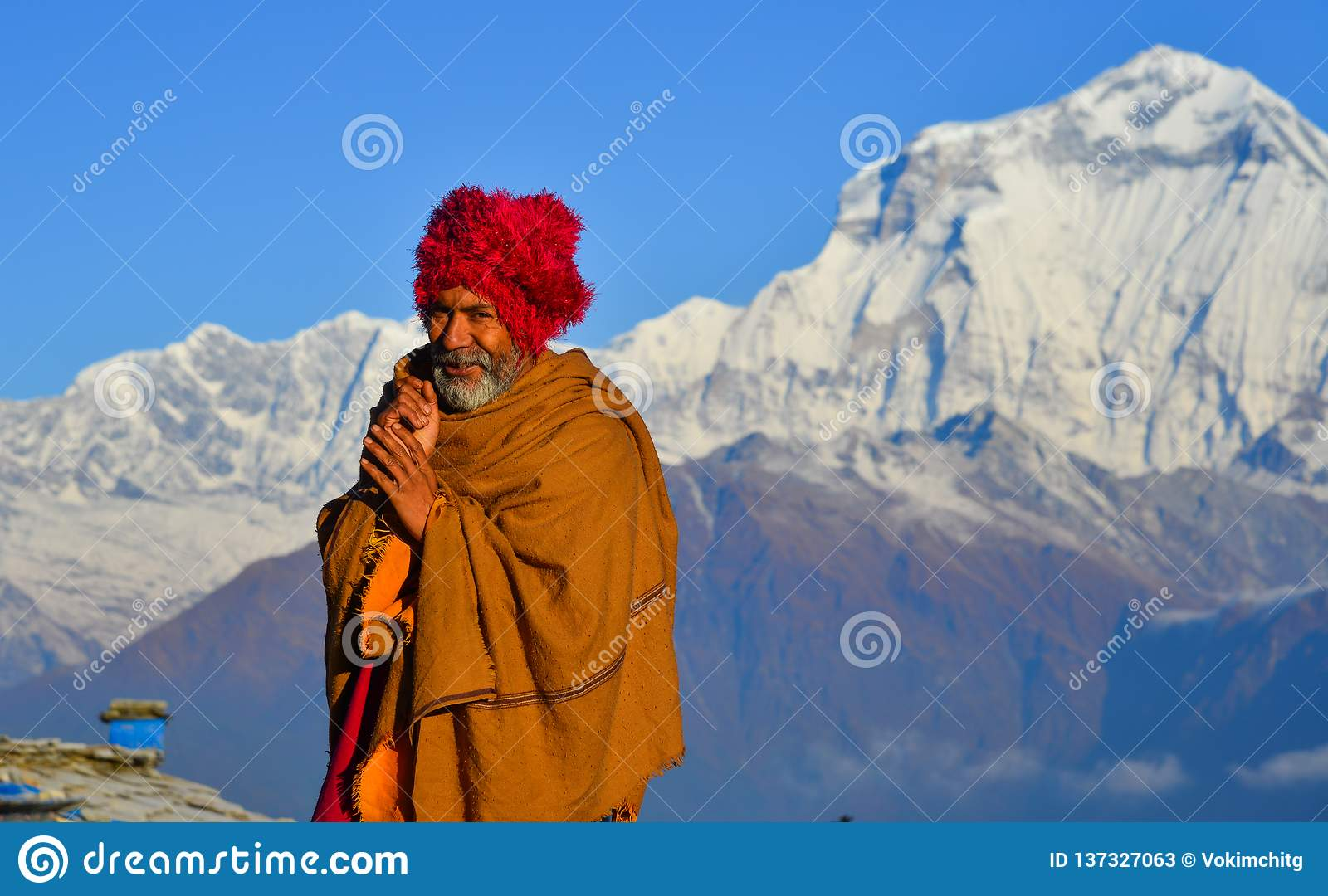 Local man on mountain in Khopra Village, Nepal