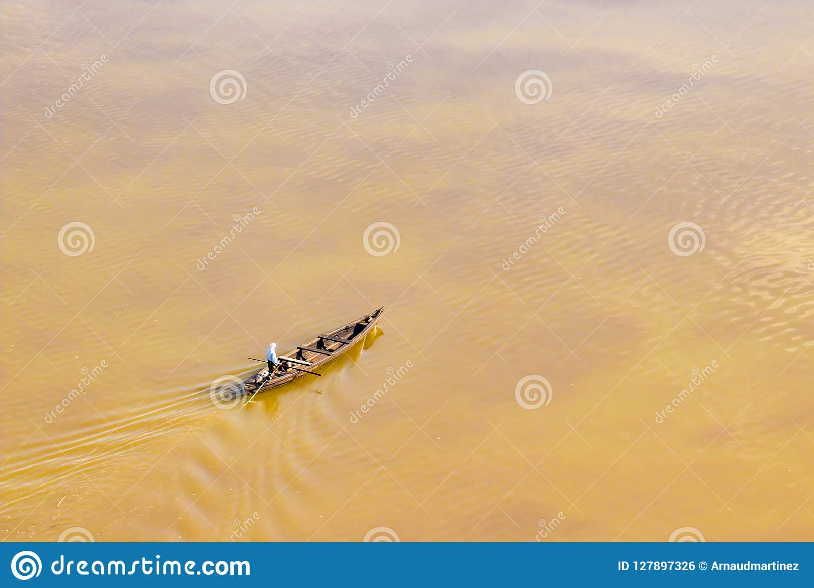 Local rescuer village boat during flooding in Kearala, India