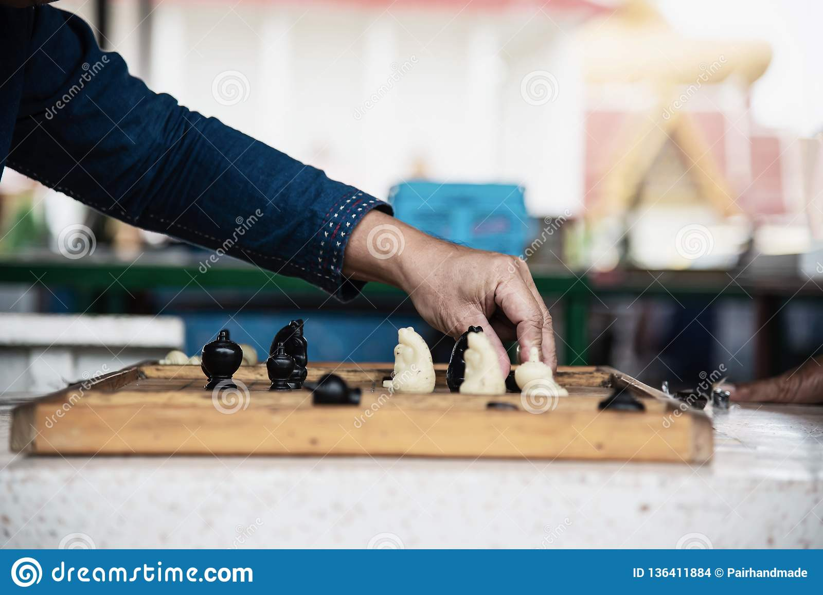Local Thai people play old traditional Thai chess in public area