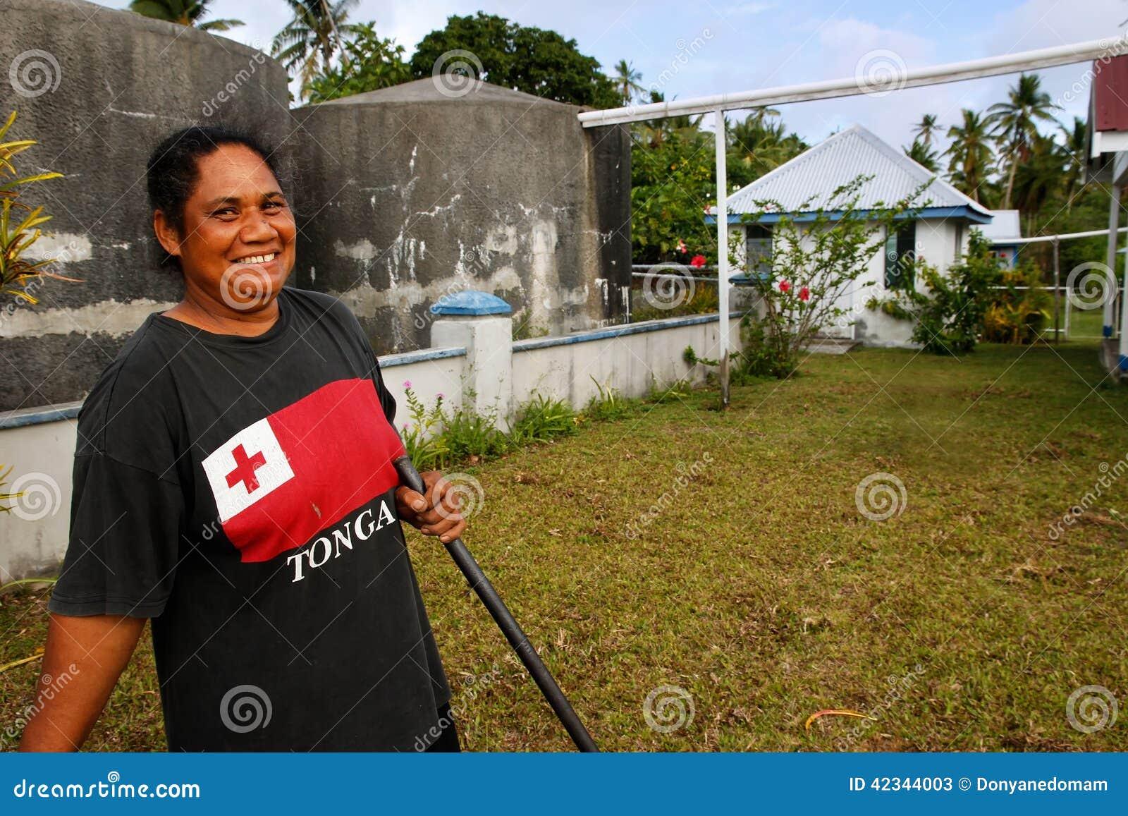local woman cleaning church yard  ofu island  tonga