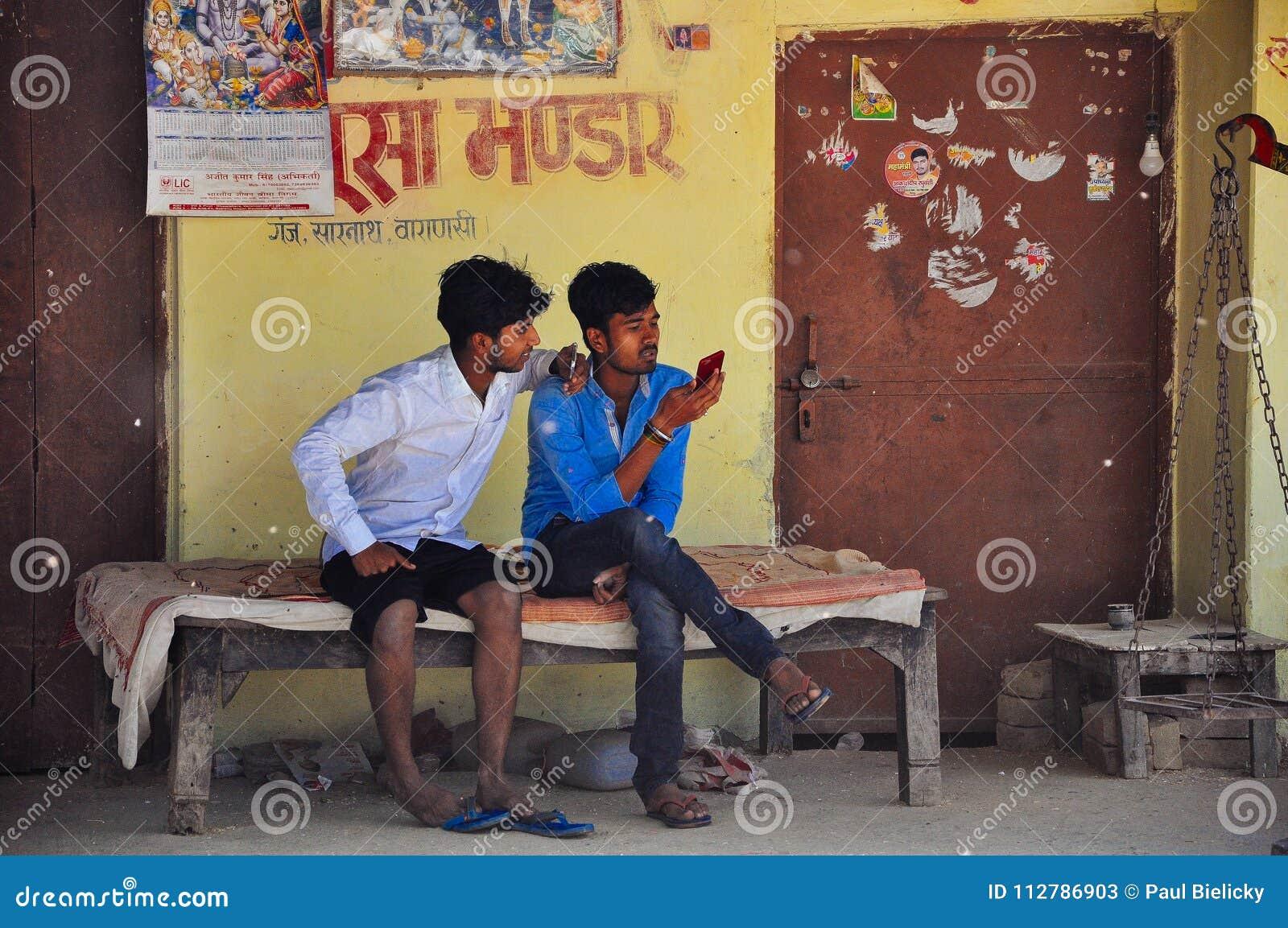 Locals check their phones in Varanasi, India.
