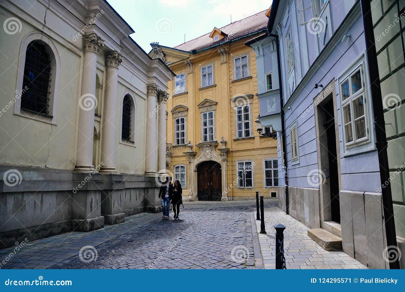 Locals walk in Old Bratislava, Slovakia.