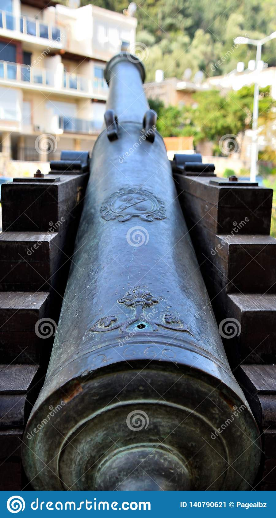Ancient cannon directed to modern building