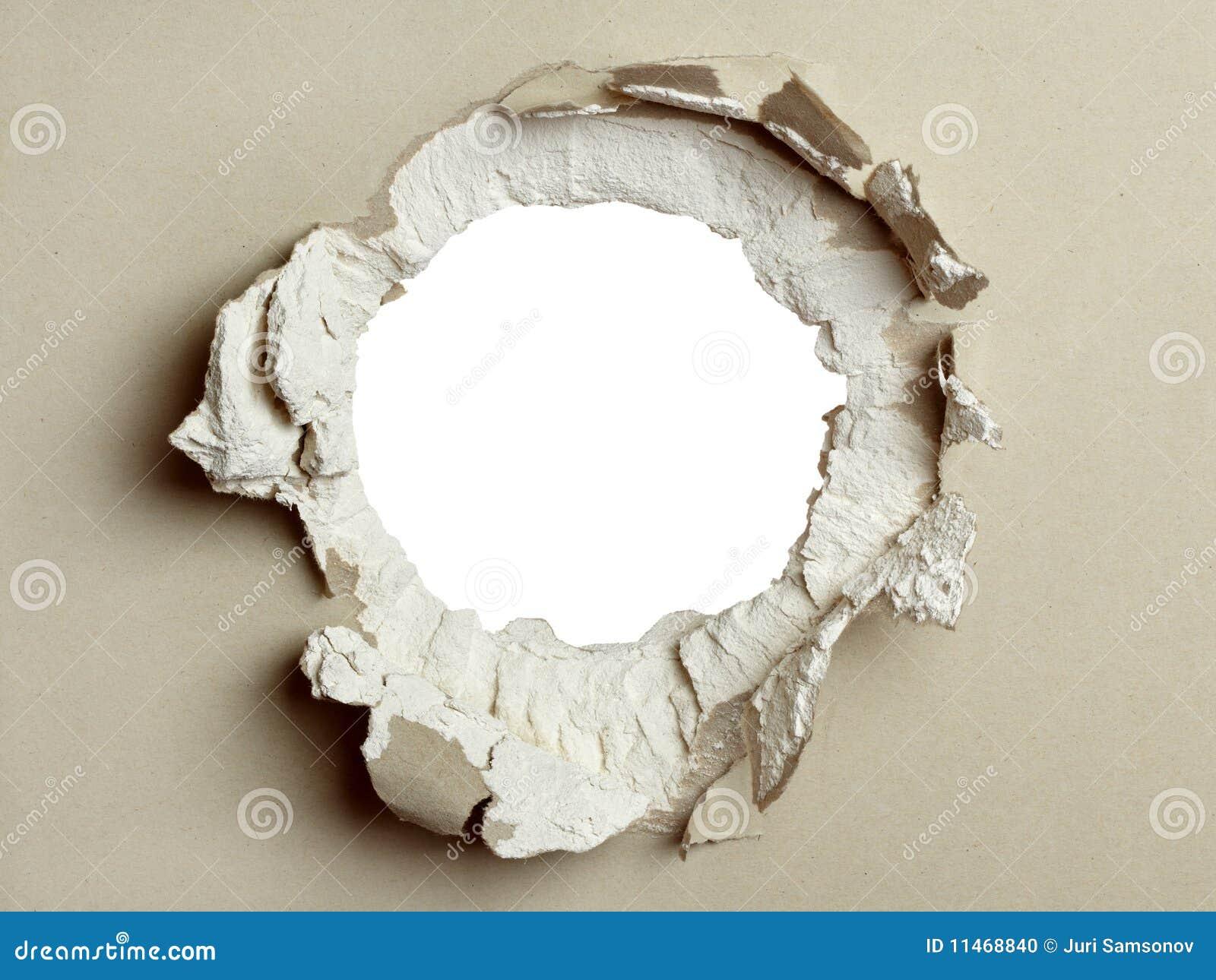 Loch in der grauen Fasergipsplatte.
