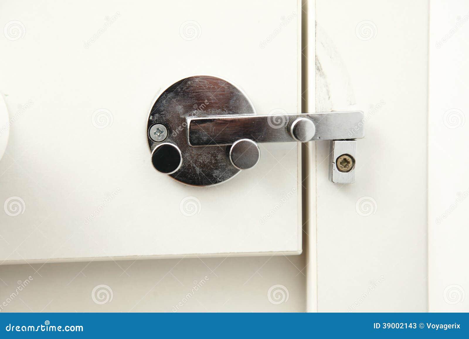 Lock on bathroom door stock photo image 39002143 - Bathroom door that fogs up when locked ...