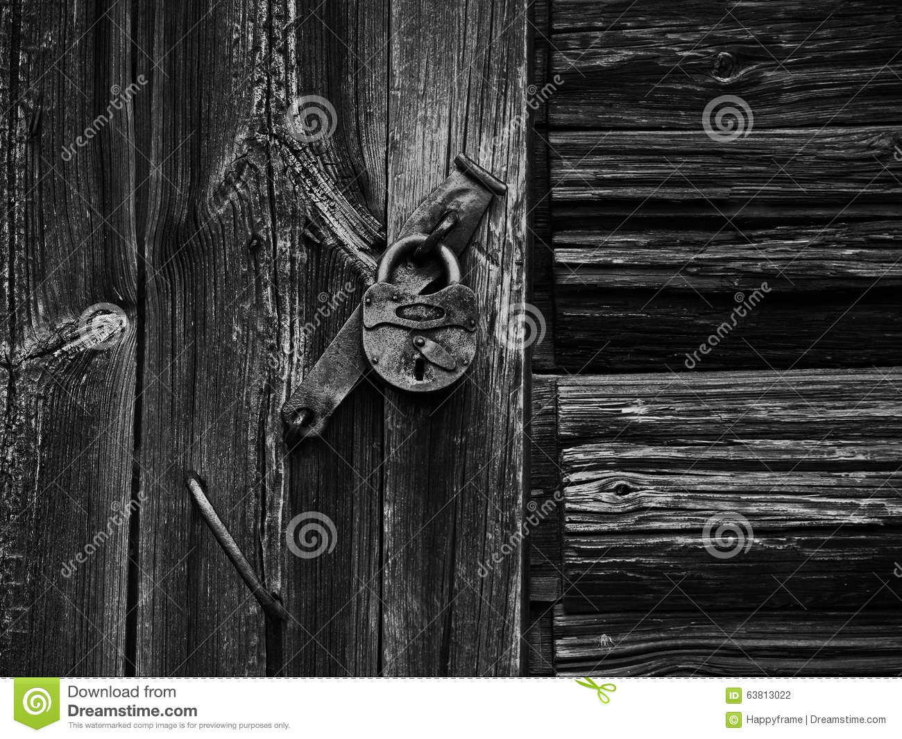 Lock on the rotten wooden wall
