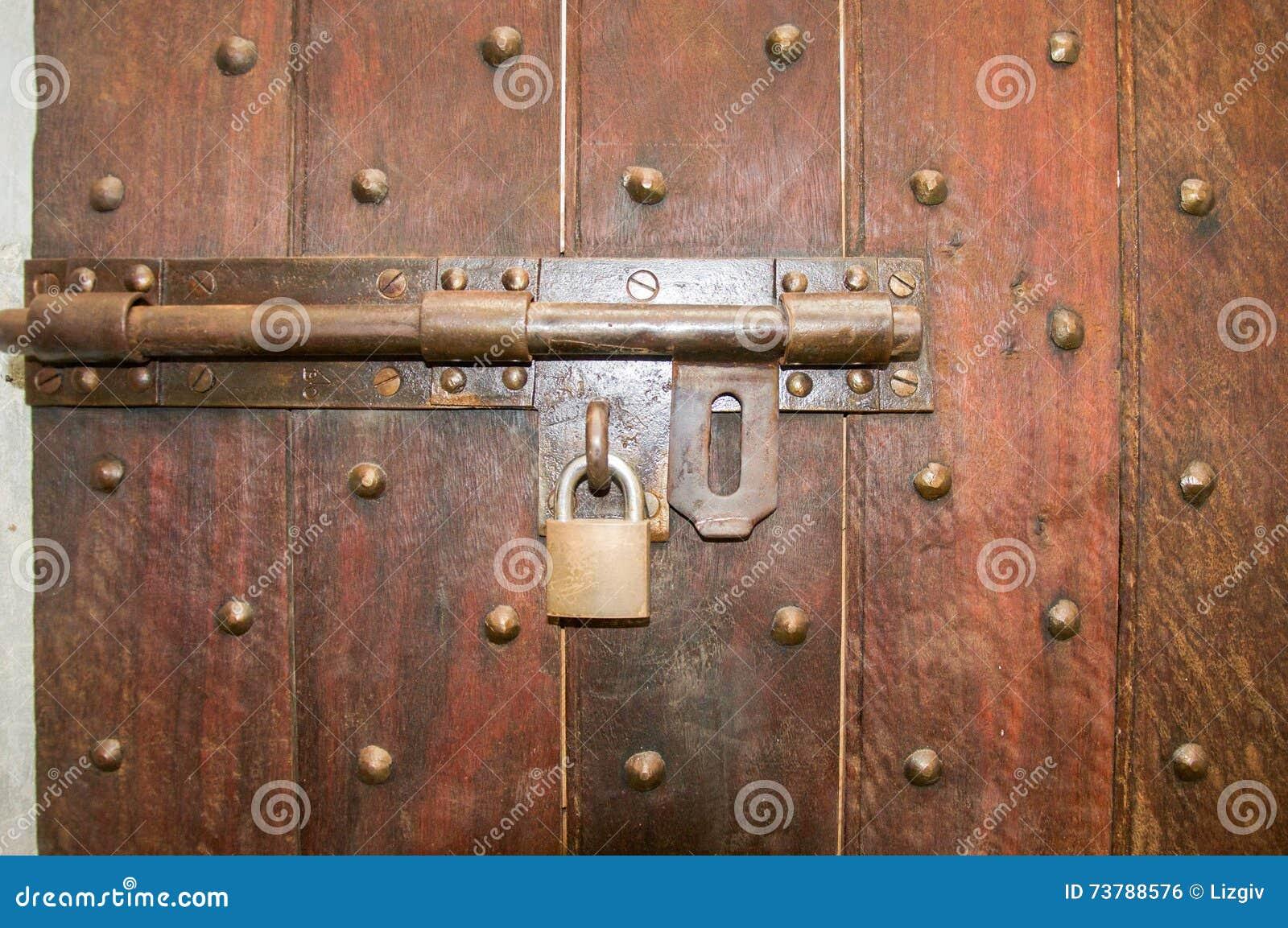 Locked and Bolted Door & Locked and Bolted Door stock photo. Image of embedded - 73788576