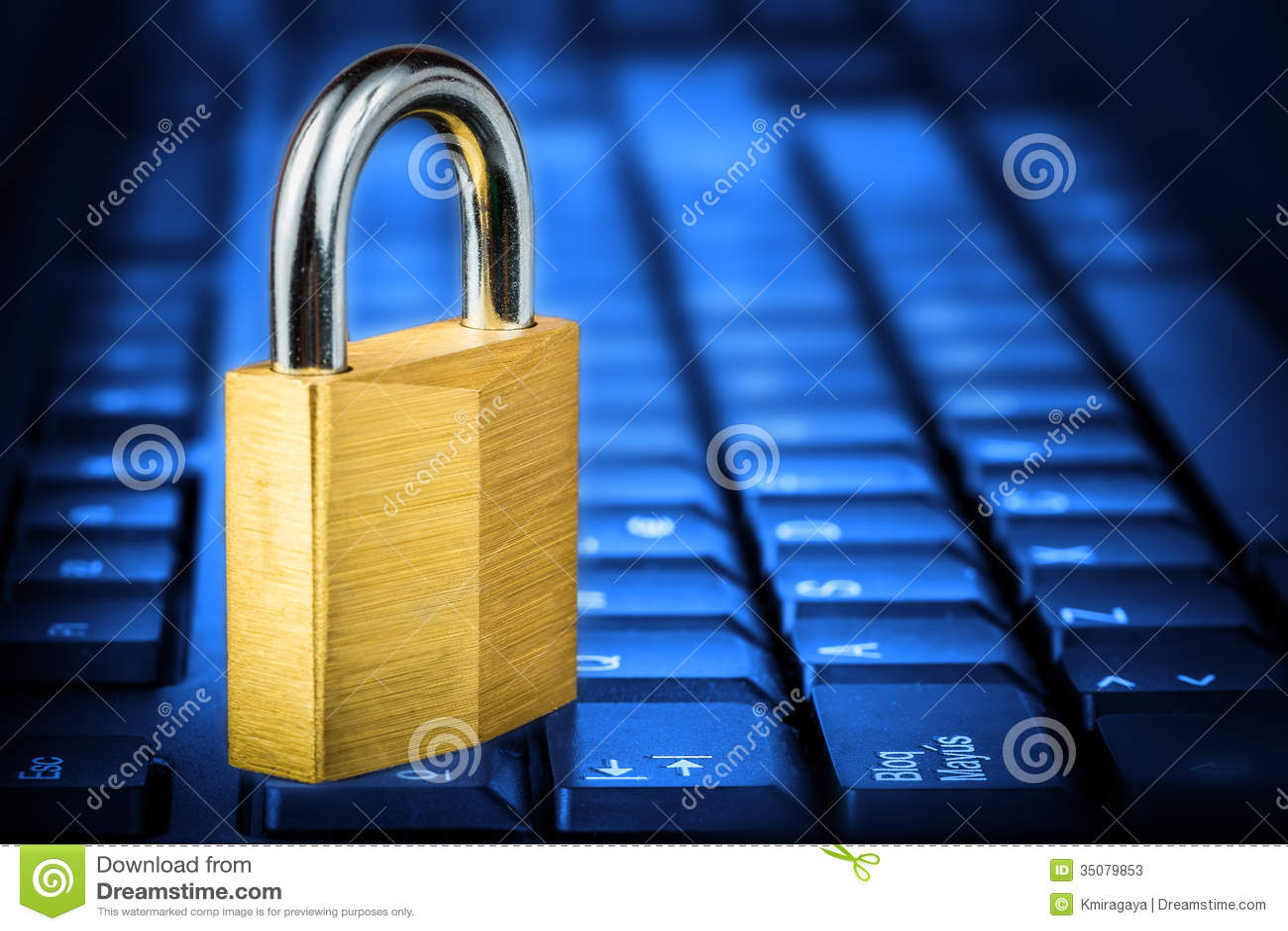 locked padlock om a glowing blue computer keyboard stock