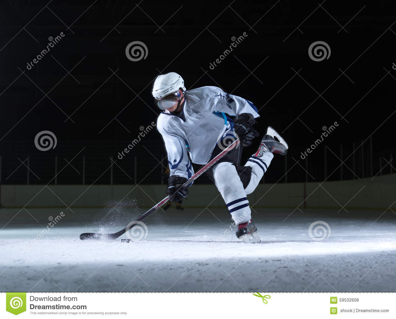 Lodowy gracz w hokeja w akci