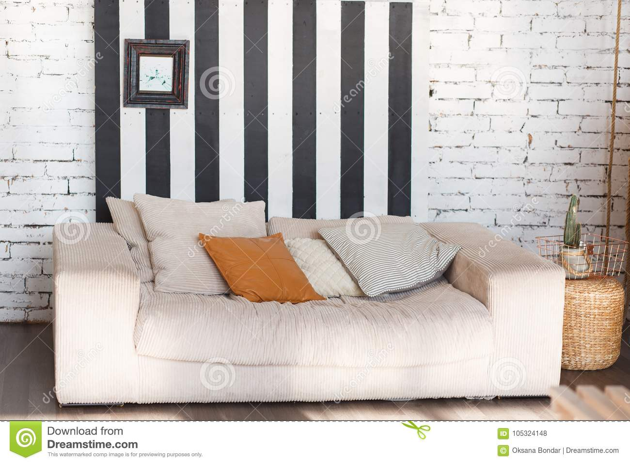 Loft modern interior with white brick wall black stripes and sofa