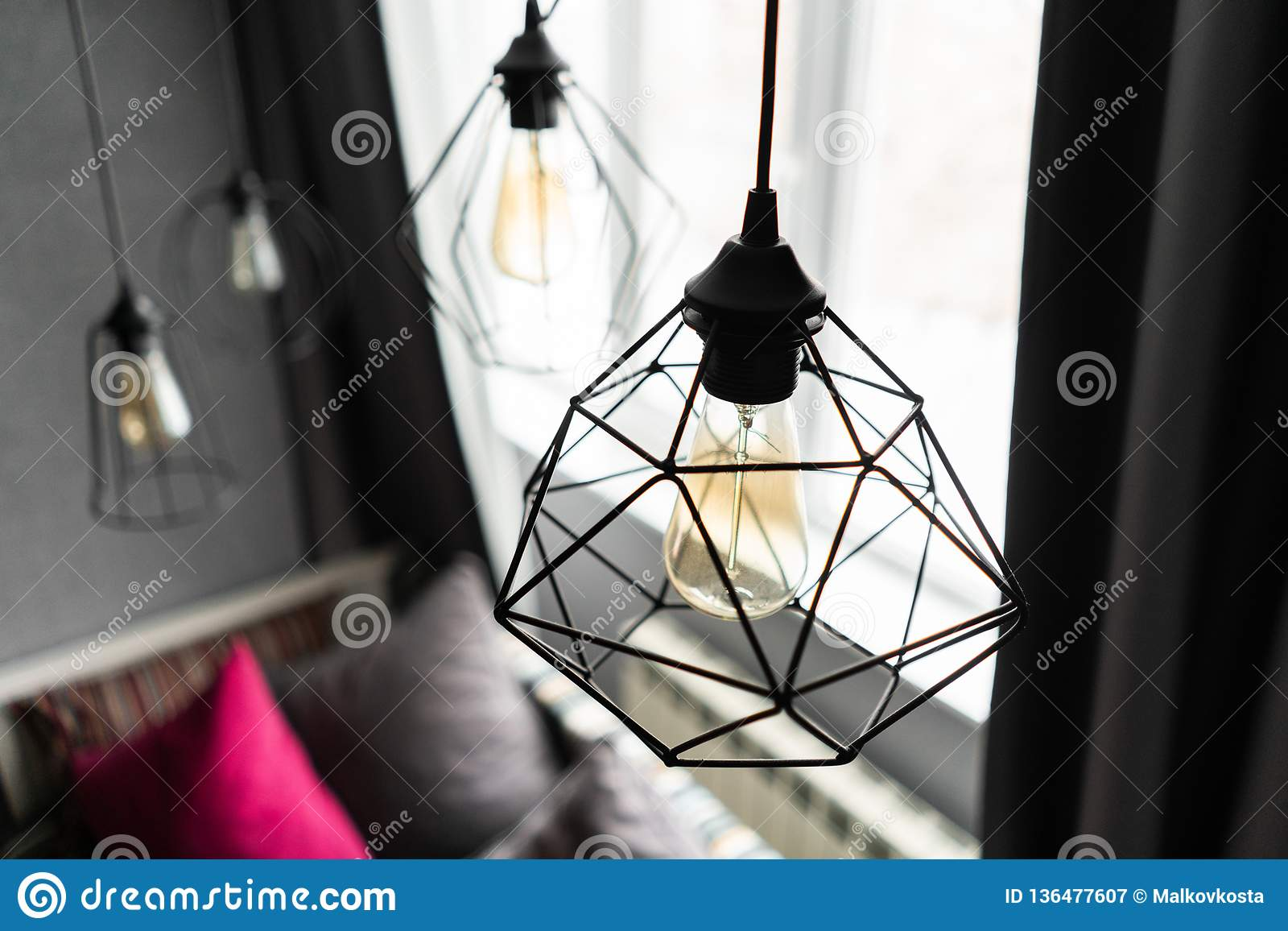 Loft Style Iron Lampshade With A Light Bulb In The Interior Living