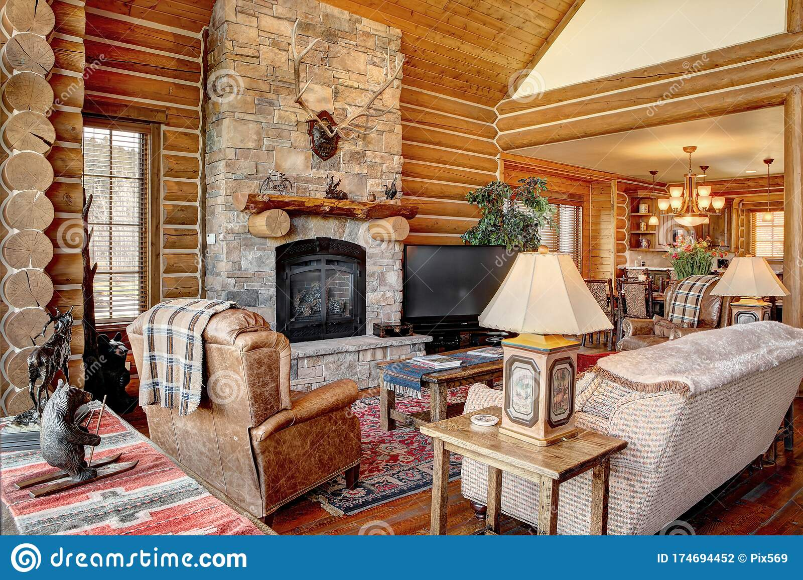 a modern log cabin living room editorial photography