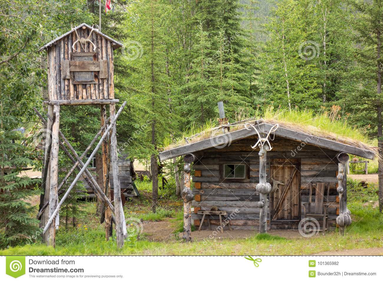 A Log Cabin And Cache In Alaska Stock Photo - Image of pretty, bench