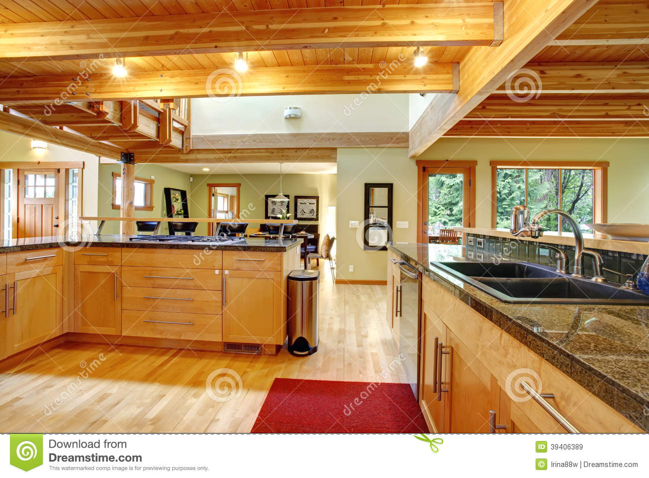 View Of Kitchen Cabinets Ceiling Beams And Hardwood Floor With Red