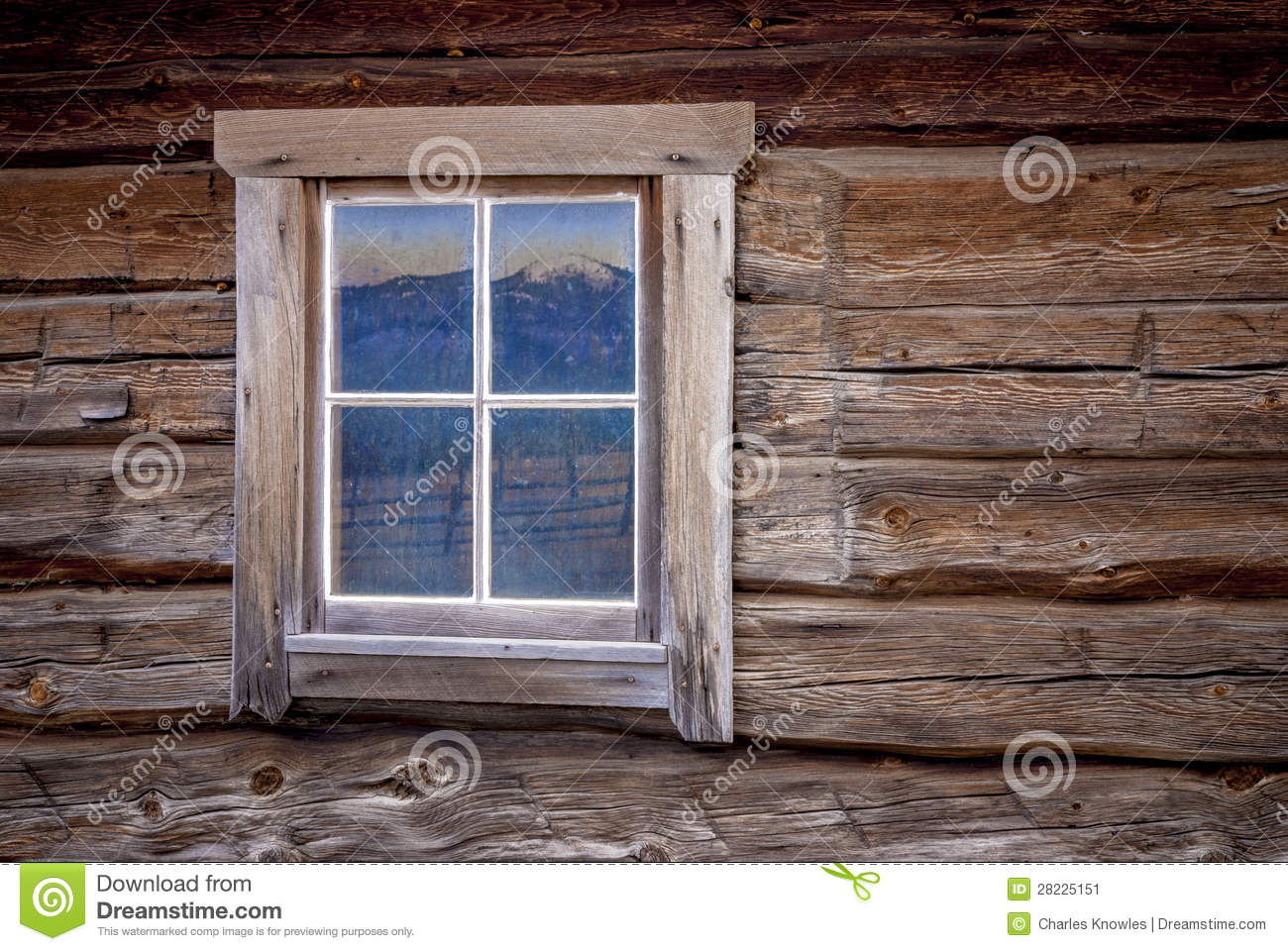 Log Cabin Window With Mountain Reflection Stock Image