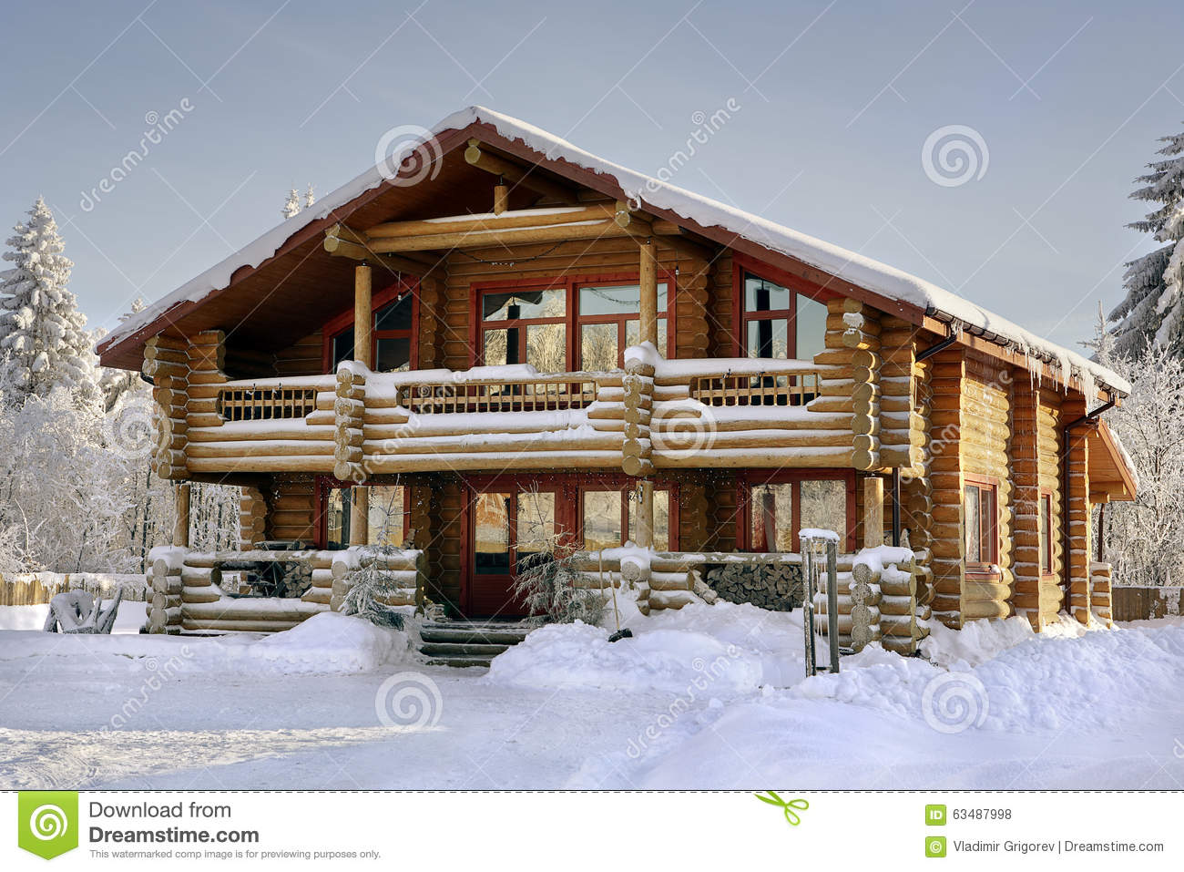 Log House Covered In Snow During Winter Stock Photo