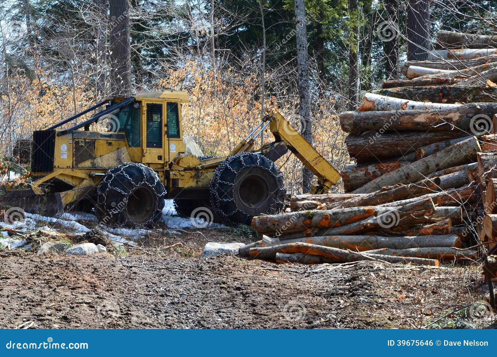 Logging skidder and logs