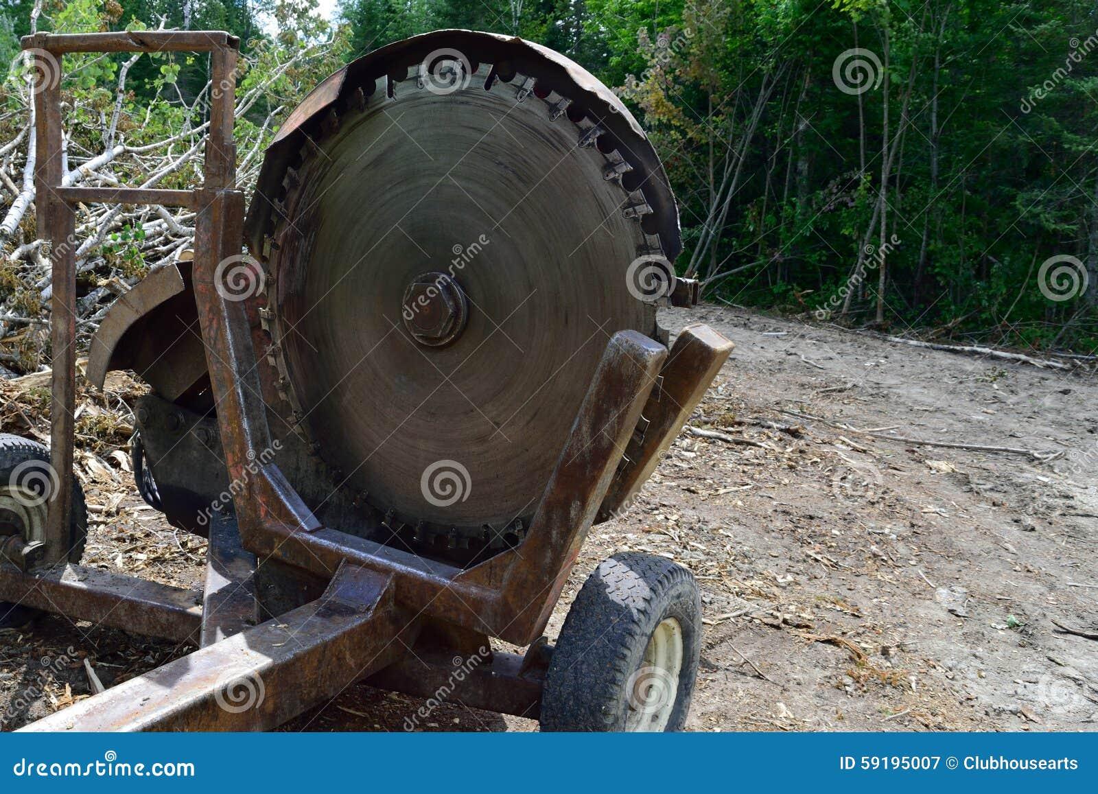 log slasher cutoff saw on landing stock photo image