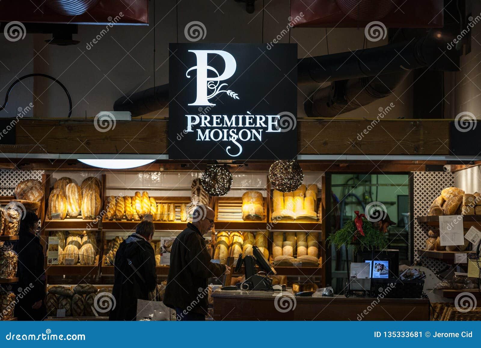 Logotipo de Moisson de la premier delante de una panadería local de Montreal, Quebec La premier Moisson es una cadena canadiense