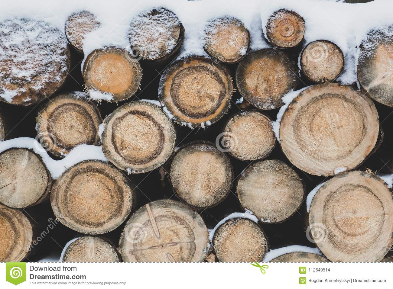 The logs are dusted with snow