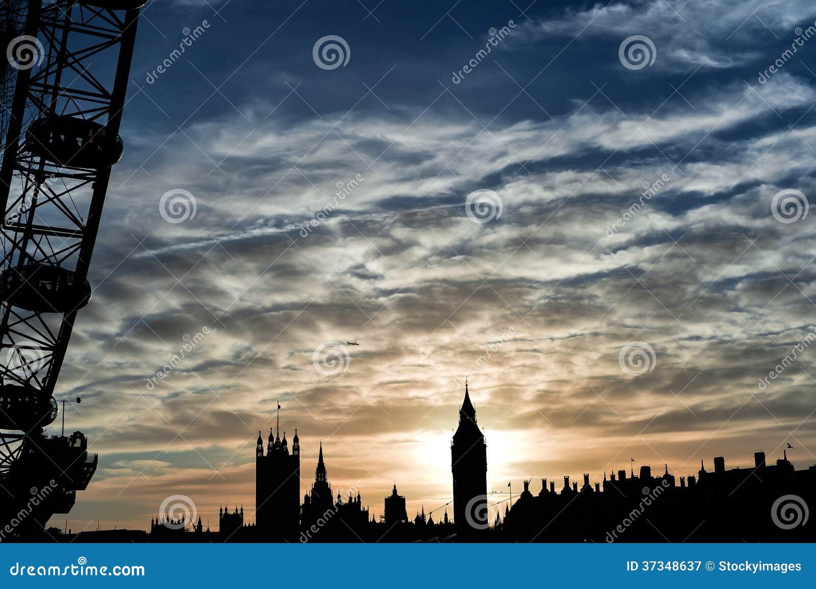 London öga och Big Ben under solnedgång