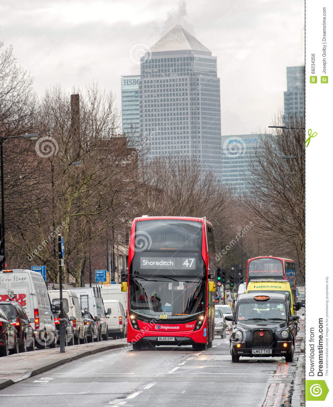London Bus And Black Cab At Rush Hour. Canary Wharf Background