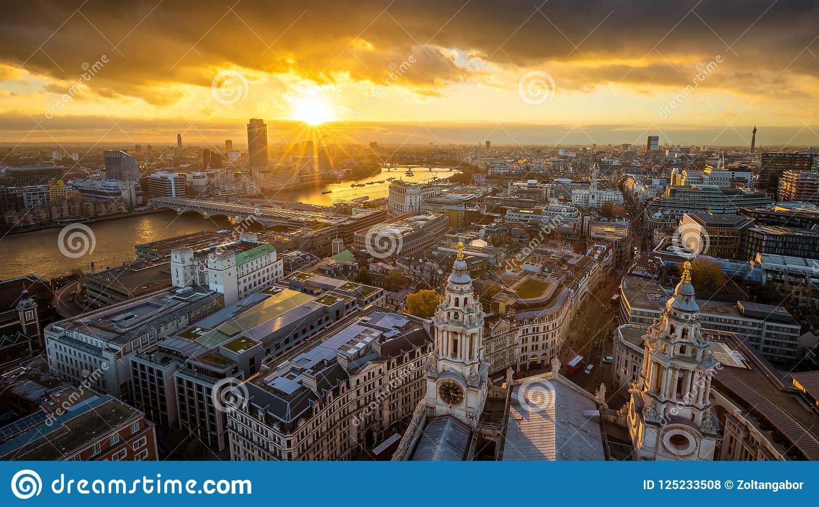 London, England - Aerial panoramic skyline view of London taken from top of St.Paul`s Cathedral at sunset