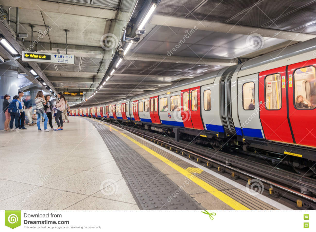LONDON, ENGLAND - AUGUST 18, 2016: Westminster Underground Station in London, England. Blurry Train because of Long Exposure.