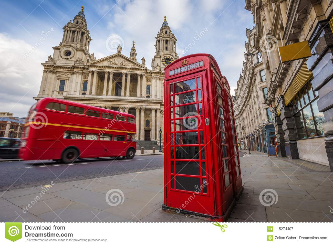London, England - Traditional red telephone box with iconic red vintage double-decker bus on the move