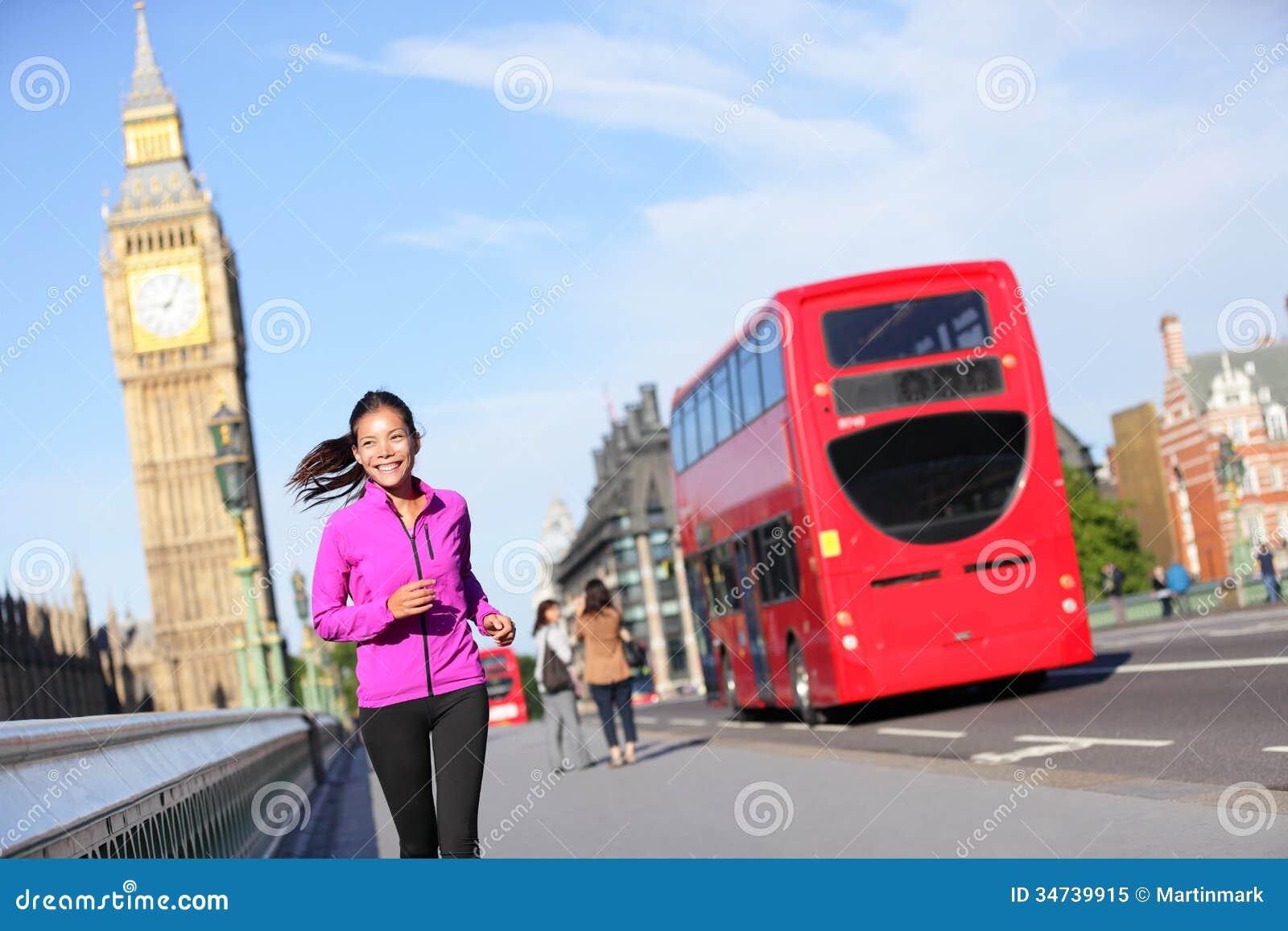 london lifestyle woman running near big ben stock image