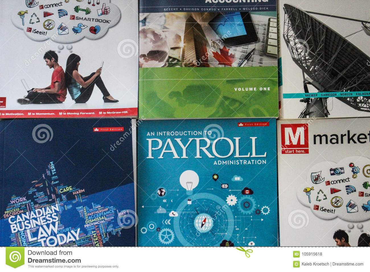 2017-12-13 - LONDON ONTARIO - EDITORIAL PHOTO OF A VARIETY OF MCGRAW HILL BUSINESS TEXTBOOKS USED IN UNIVERSITIES AND COLLEGES