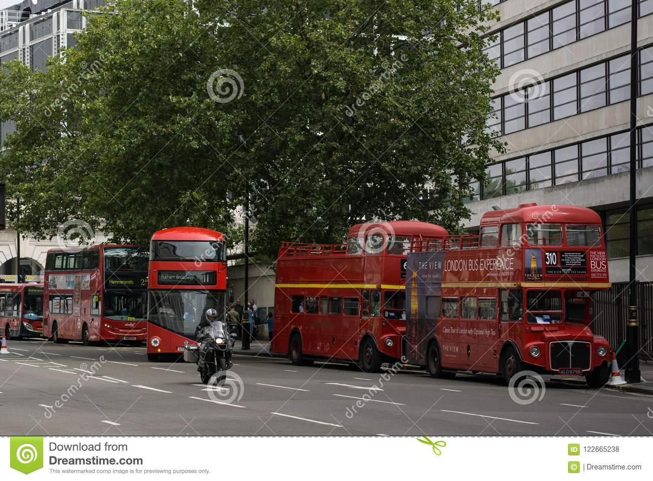 London red buses of old and new style next to eachother