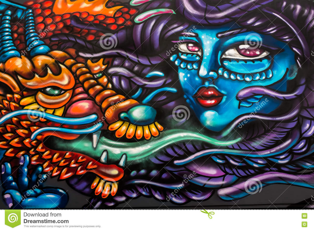Abstract graffiti of womans face and dragon with green tongue east london uk