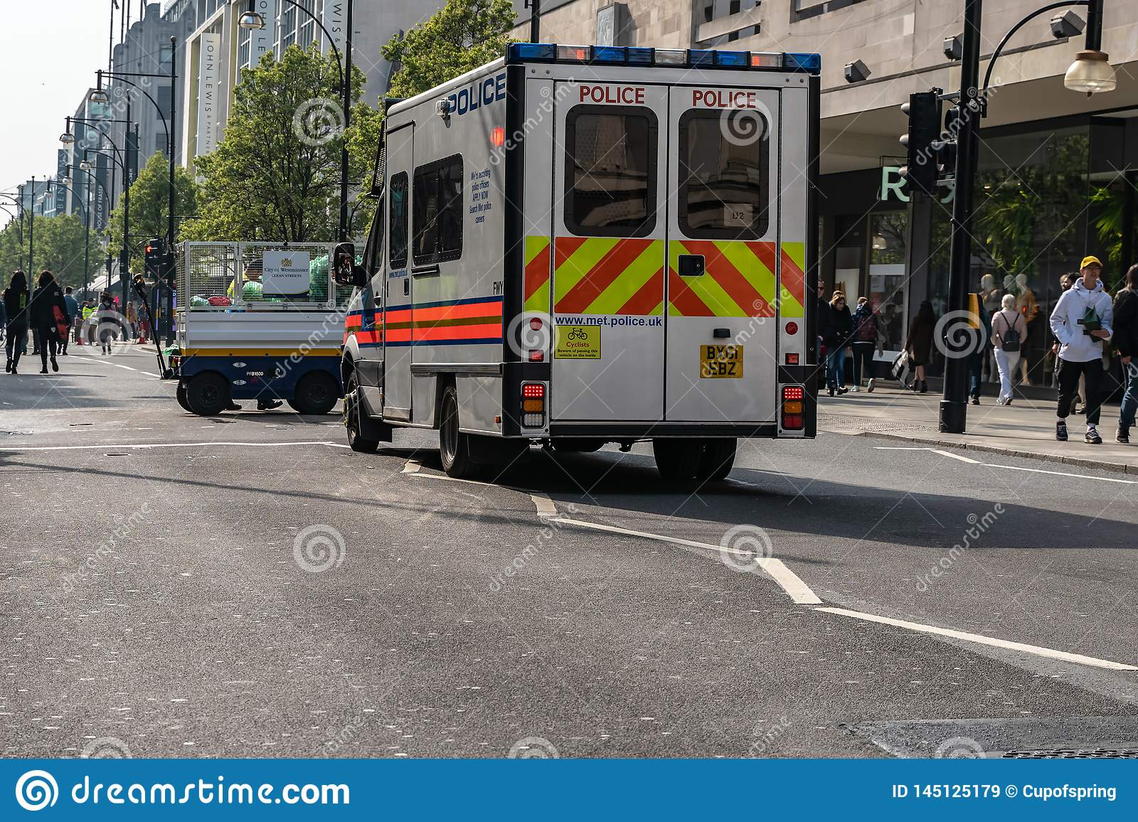London, UK - April 15, 2019: Police van on the Oxford street. Extinction Rebellion campaigners blocked Oxford Circus, Marble Arch