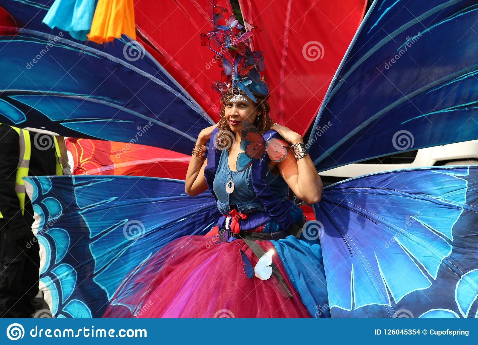 Notting Hill Carnival Woman wearing colorful butterfly wing costume