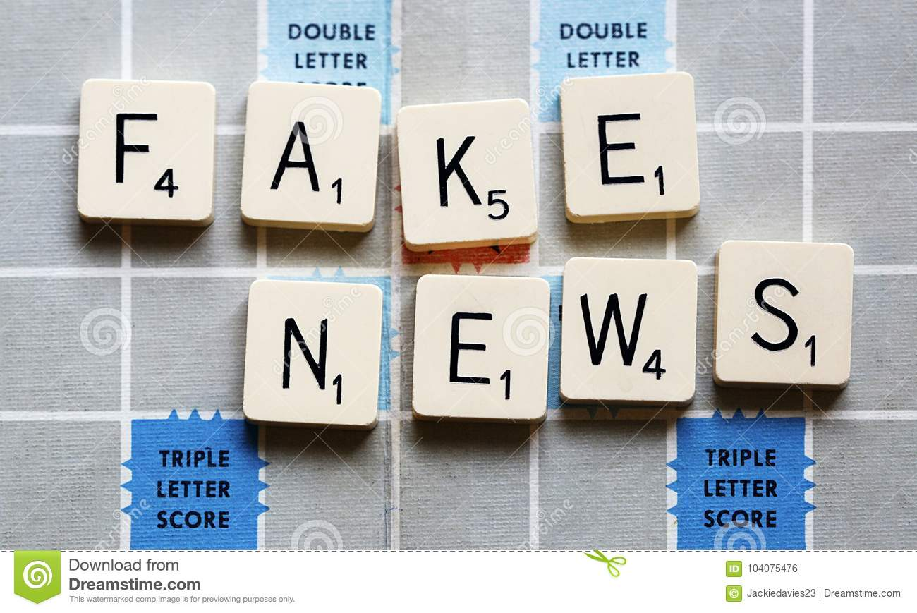 fake news concept game spelling fake news