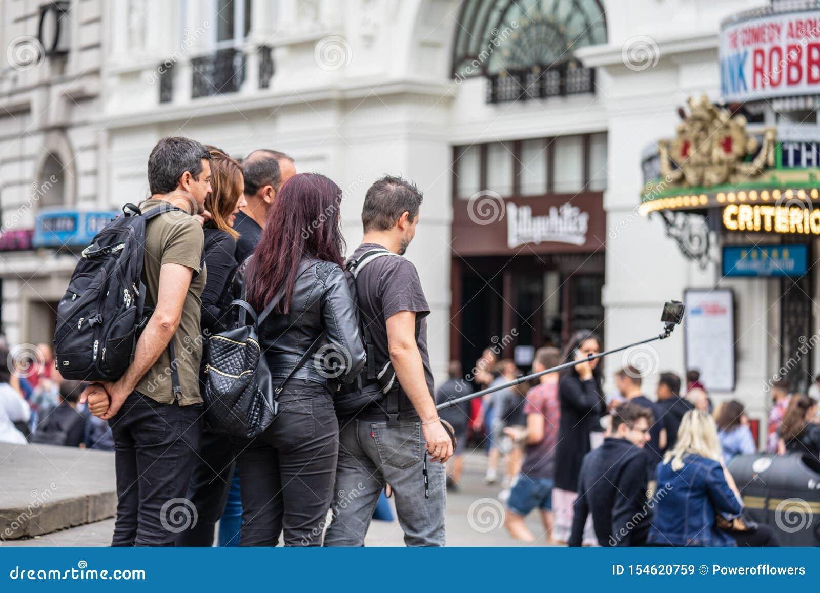 London, UK, July, 2019. Close up portrait of happy attractive people taking selfie in London