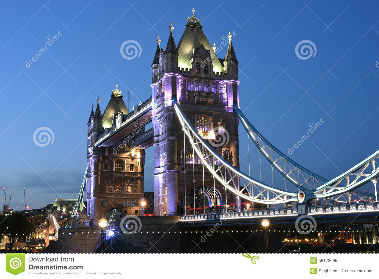 London UK, Majestic Tower Bridge at night with light trails of bus and cars, artistic long exposure night shot
