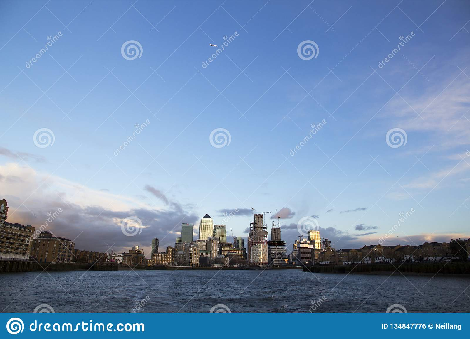 London cityscape across the River Thames with a view of Canary Wharf, London, England, UK, May 20, 2017