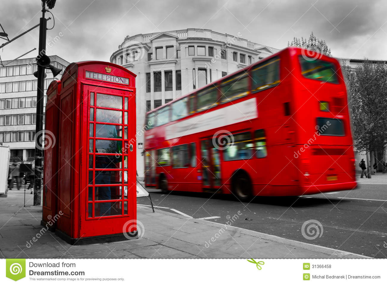 London, the UK. Red phone booth and red bus