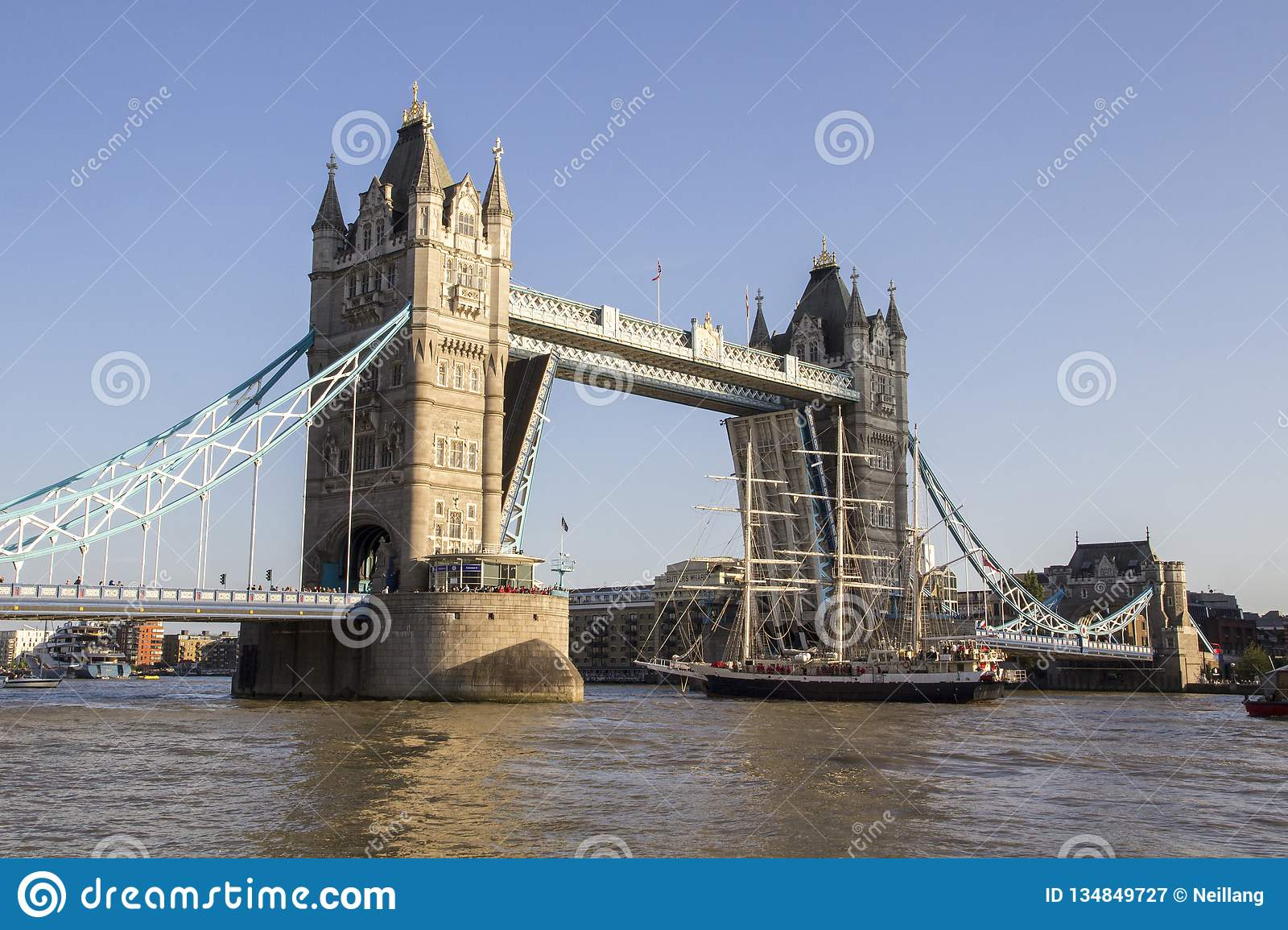 View of Tower Bridge on the River Thames opening for the Lord Nelson tall ship. London, England,