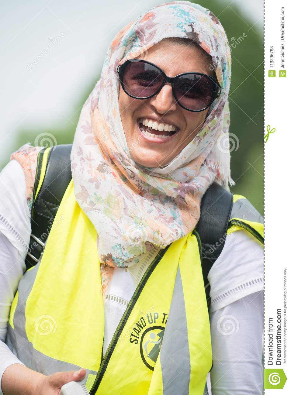 Happy muslim woman at the counter-demo by pressure group Unite Against Fascism in Whitehall, London, UK.