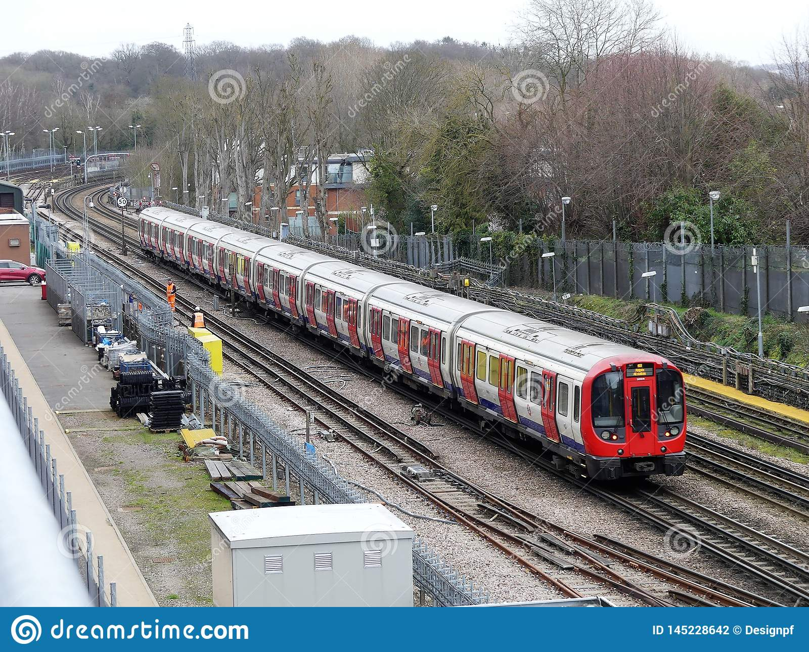 London Underground train passing by on track in Rickmansworth