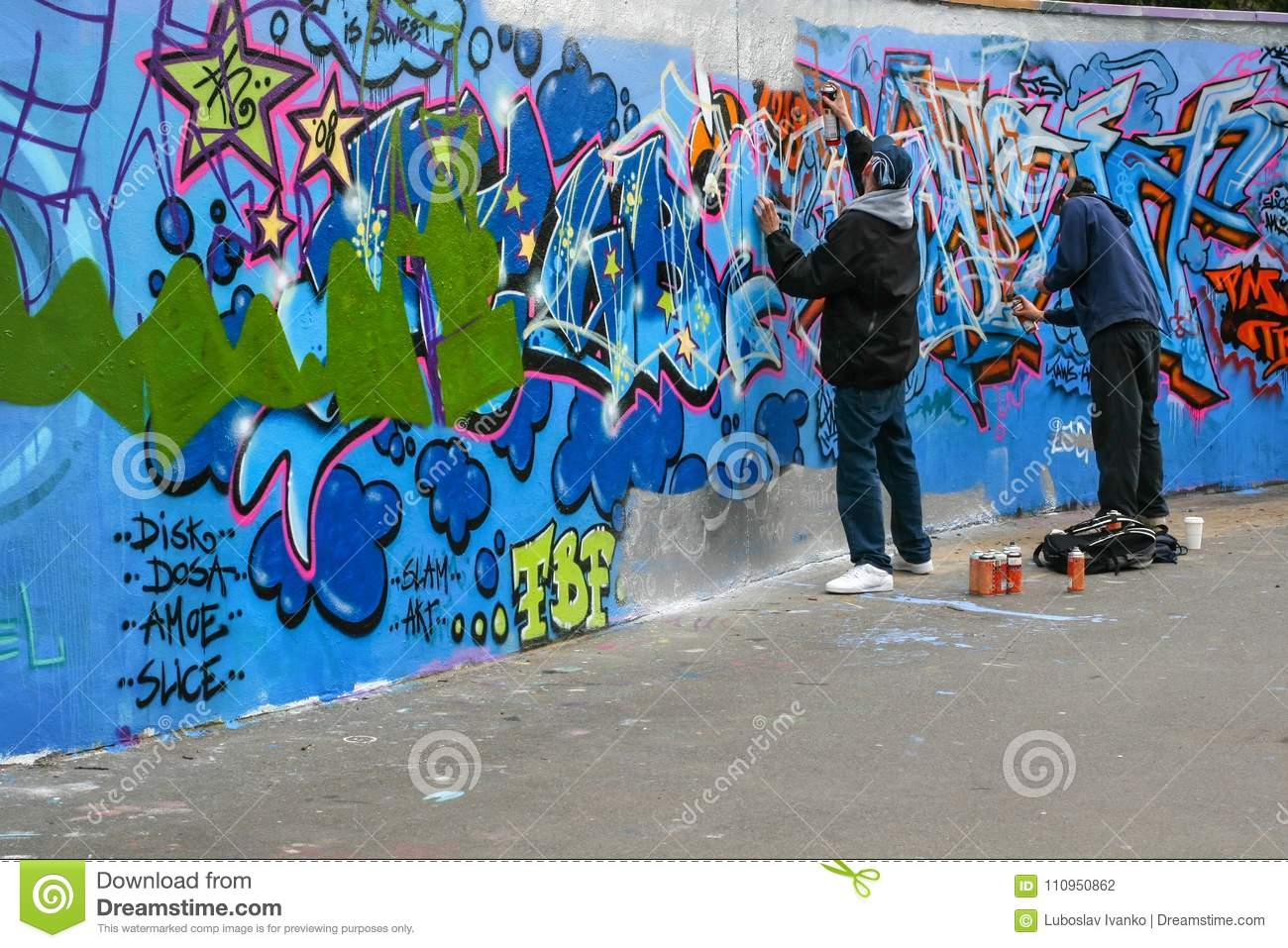 two boys spraying graffiti editorial photography image of anarchy