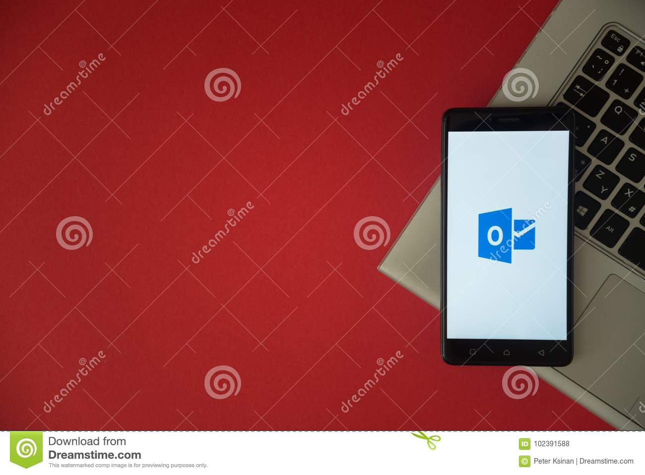 Microsoft Office Outlook Logo On Smartphone Screen Placed On Laptop