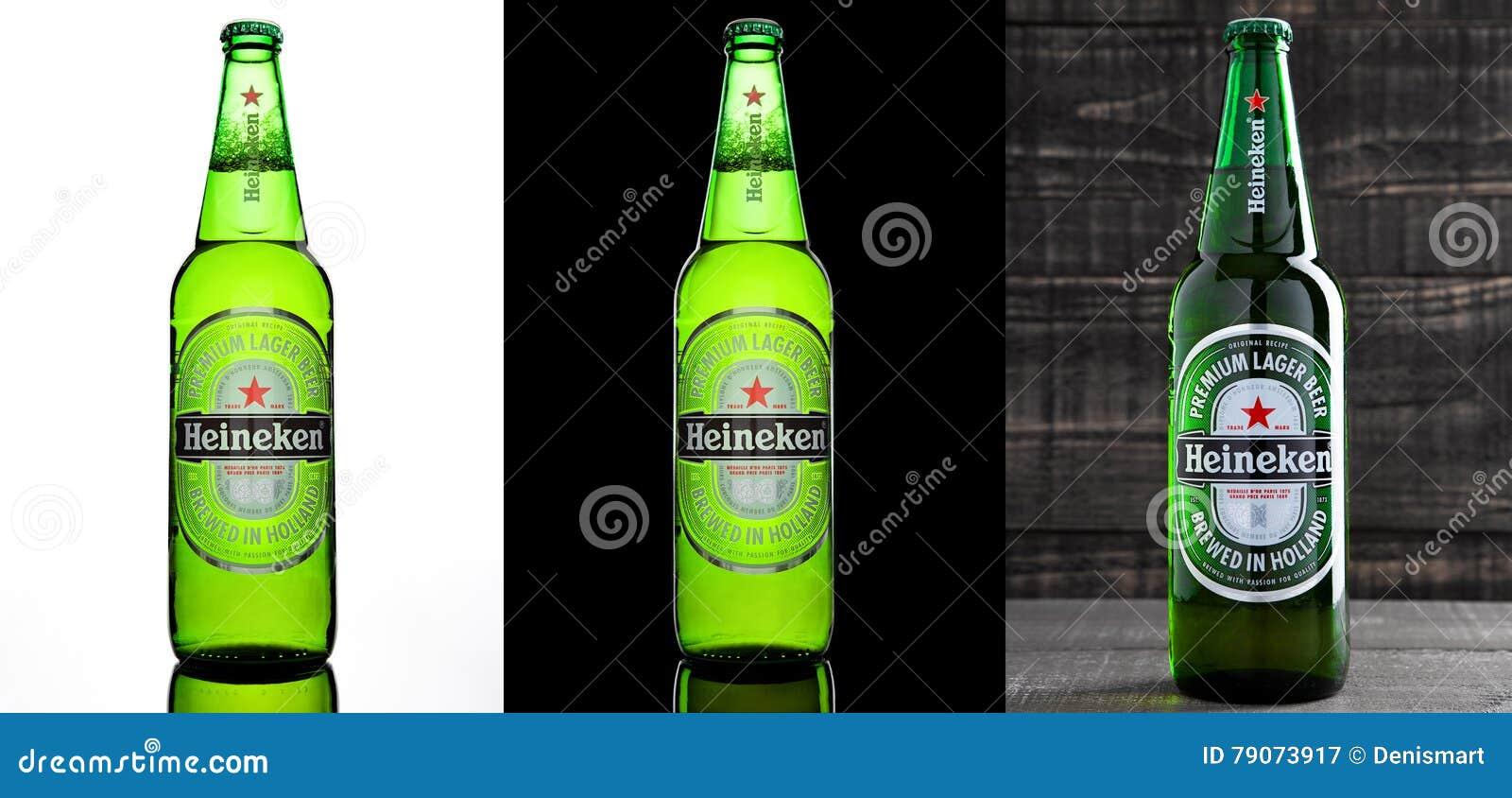 LONDRES, REINO UNIDO - 17 DE OCTUBRE DE 2016: Botella de Heineken Lager Beer en tres diversos fondos Heineken es el productor est