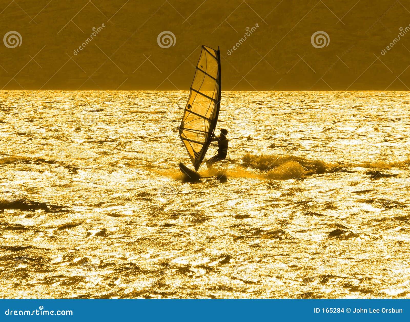 Lone windsurfer at sunset