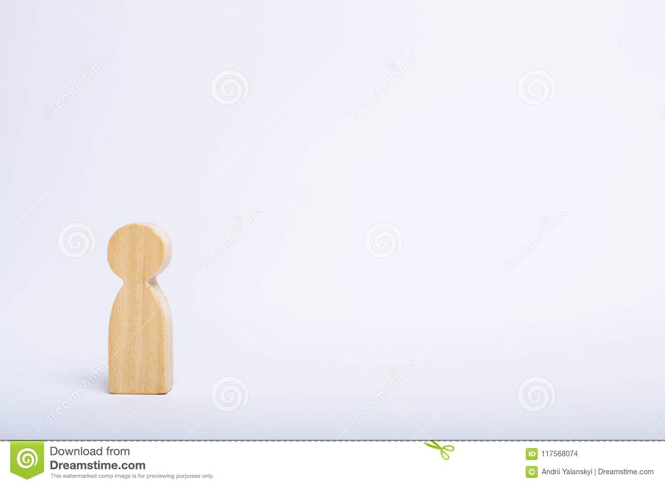 A lone wooden human figure stands on a white background. A person is waiting, standing and waiting. Style of minimalism, space