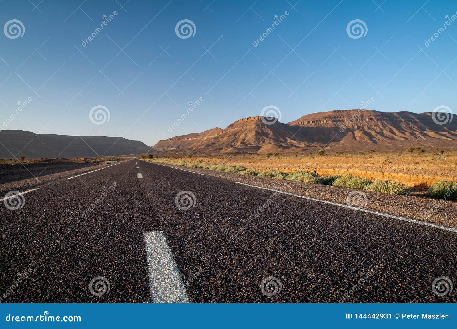 Straight asphalt road in the desert of Morocco