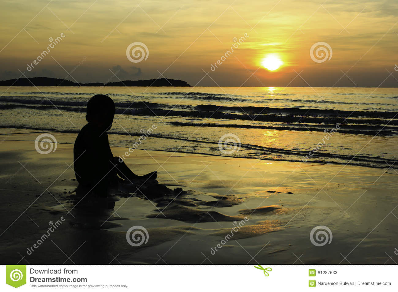 Lonely boy playing alone on the beach with sunrise stock photos